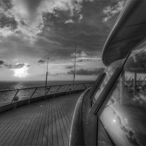 deck of a luxury cruise ship at dusk